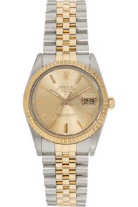 Date Circa 1960s Yellow Gold and Stainless Steel Automatic